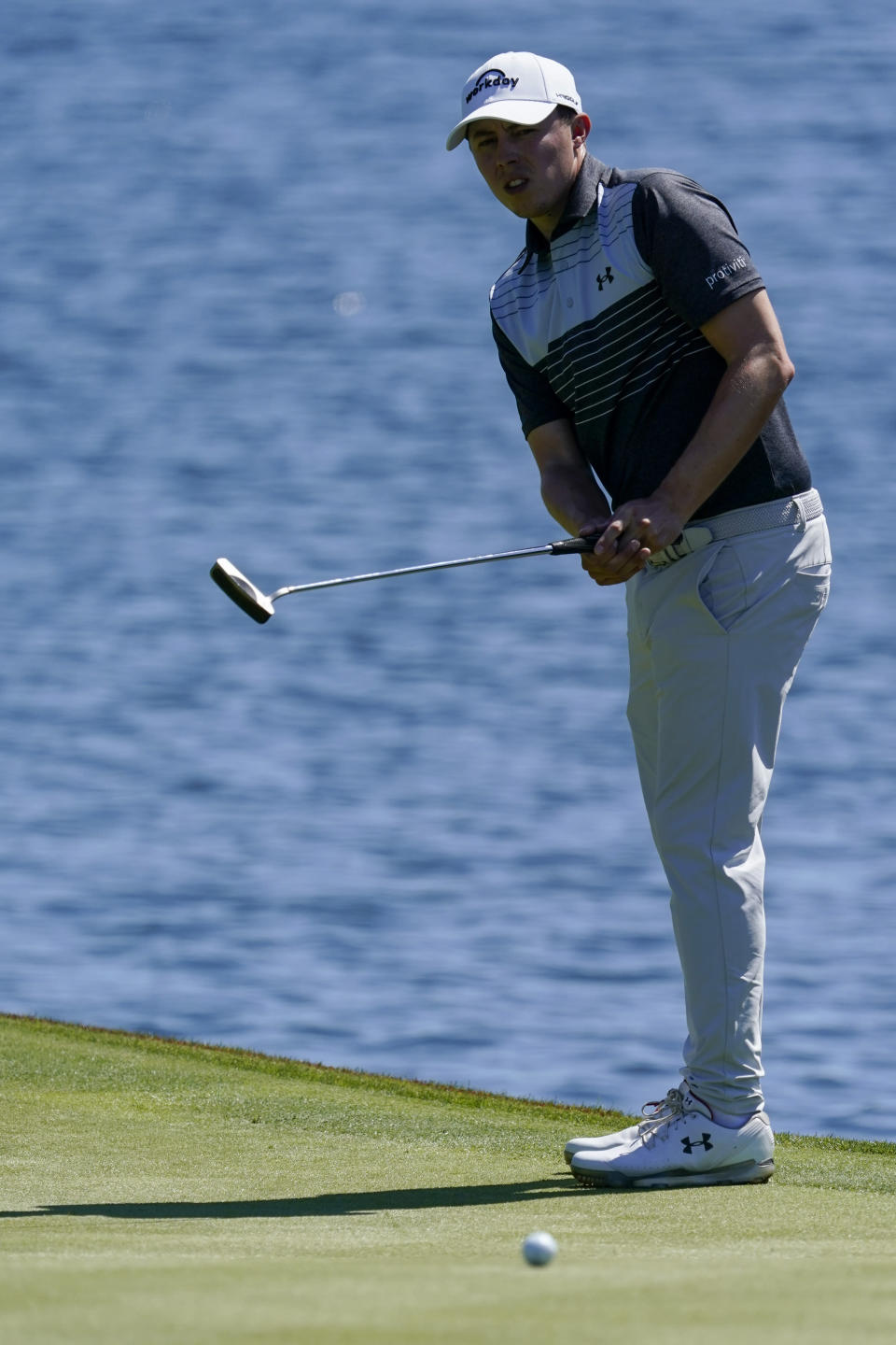 Matthew Fitzpatrick of England watches his putt on the 18th hole during the first round of the The Players Championship golf tournament Thursday, March 11, 2021, in Ponte Vedra Beach, Fla. (AP Photo/John Raoux)