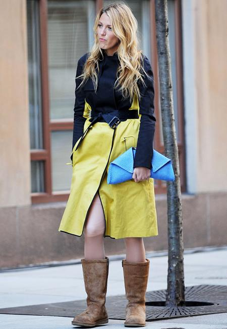 Celebrity fashion: From the head down, Blake Lively's look is near perfect… the lemon and black Reed Krakoff coat, the baby-blue Emily Cho python clutch and then we spy her footwear. Filming Gossip Girl is no excuse these boots ruin it.