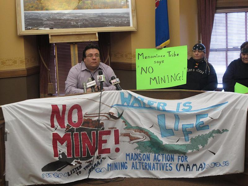"""Bad River Band of Lake Superior Chippewa chairman Mike Wiggins Jr. promised an """"all-out effort"""" to stop an iron ore mine near the tribe's reservation on Thursday, March 7, 2013, in Madison, Wis. Wiggins and other tribal leaders spoke out against the mine as the state Assembly debated a bill designed to help ease the regulatory process to allow it. (AP Photo/Scott Bauer)"""