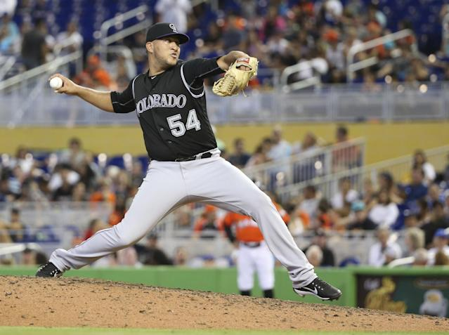 <p>Colorado Rockies' Carlos Estevez delivers a pitch during the eighth inning of a baseball game against the Miami Marlins, Sunday, Aug. 13, 2017, in Miami. The Marlins defeated the Rockies 5-3. (AP Photo/Wilfredo Lee) </p>