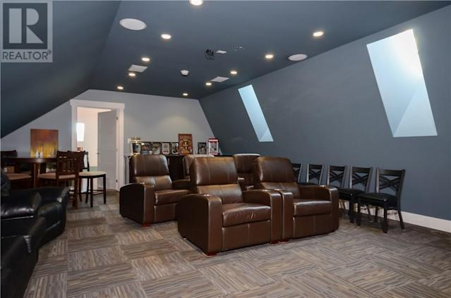 <p><span>57 Clear View Rd., Grand Barachois, N.B.</span><br> The home also has some great dedicated-purpose rooms, like this home theatre, as well as a wine cellar.<br> (Photo: Zoocasa) </p>