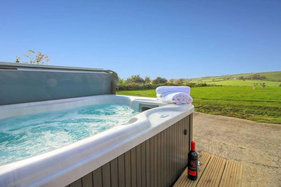 """<p>Want a Cornwall Airbnb with a hot tub? Check out The Shippon on the edge of Bodmin Moor. The converted barn affords a peaceful location and all the essentials for a romantic break. </p><p>There's the International Dark Sky Landscape for stargazing, the private hot tub for a bubbly soak and the seclusion to feel a world away from the stresses of daily life.</p><p><strong>Sleeps</strong>: 2</p><p><strong>Price per night:</strong> £107</p><p><strong>Why we love it: </strong>The relaxing views and rural location. If you want to get away from it all in a spot with amazing views, The Shippon won't disappoint.</p><p><a class=""""link rapid-noclick-resp"""" href=""""https://www.airbnb.co.uk/rooms/15479487?source_impression_id=p3_1592740934_PxPIPakoAhVTf2cd&guests=1&adults=1"""" rel=""""nofollow noopener"""" target=""""_blank"""" data-ylk=""""slk:SEE INSIDE"""">SEE INSIDE</a></p>"""