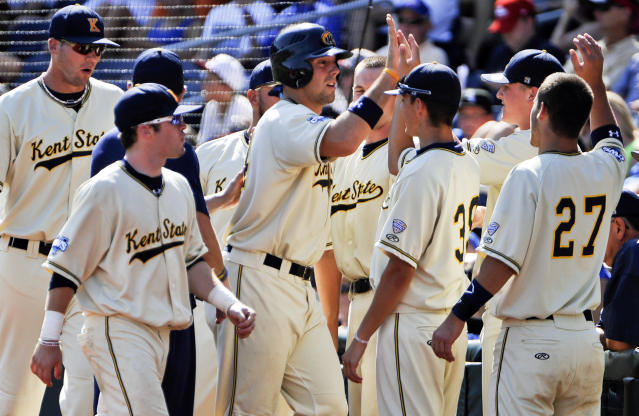 Kent State's Jason Bagoly, center, is congratulated by teammates after he scored against Florida on a single by Jimmy Rider in the second inning of an NCAA College World Series elimination baseball game in Omaha, Neb., Monday, June 18, 2012. (AP Photo/Eric Francis)