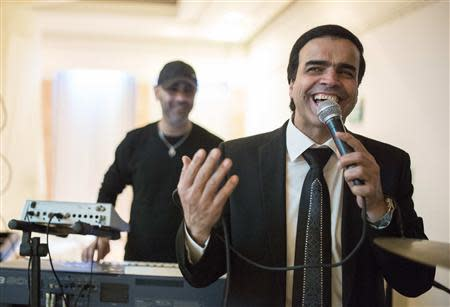 Israeli singer Zion Golan performs at a wedding celebration in the southern town of Netivot February 10, 2014. REUTERS/Amir Cohen