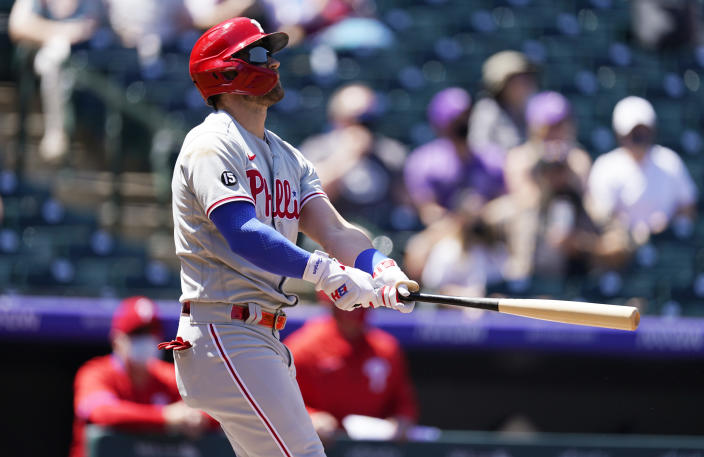 Philadelphia Phillies' Bryce Harper follows the flight of his solo home run off Colorado Rockies starting pitcher Jon Gray in the first inning of a baseball game Sunday, April 25, 2021, in Denver. (AP Photo/David Zalubowski)