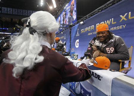 Denver Broncos outside linebacker Danny Trevathan is interviewed by a reporter dressed in a period costume during Media Day for Super Bowl XLVIII at the Prudential Center in Newark, New Jersey January 28, 2014. REUTERS/Shannon Stapleton