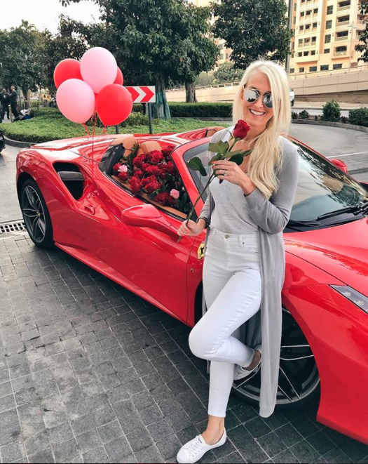 And here's the lucky lady who received the Ferrari as a gift. Photo: Instagram/supercarblondie