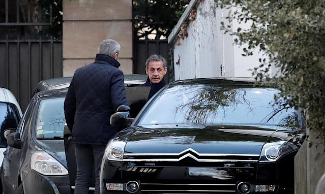 Former French President Nicolas Sarkozy enters his car as he leaves his house in Paris, France, March 21, 2018. REUTERS/Benoit Tessier TPX IMAGES OF THE DAY