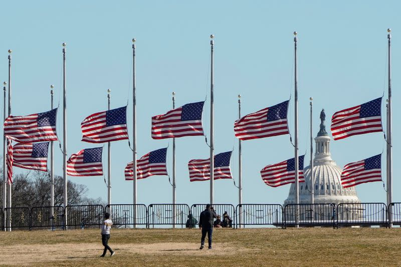 FILE PHOTO: Flags fly at half staff in memory of 500,000 deaths due to the COVID-19 in Washington