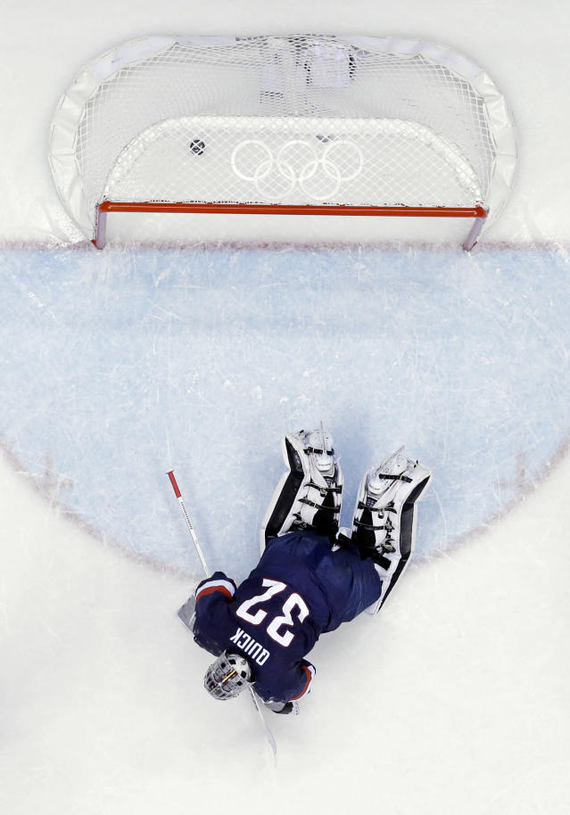 USA goaltender Jonathan Quick lays on the ice after giving up a goal during the third period of the men's bronze medal ice hockey game against Finland at the 2014 Winter Olympics, Saturday, Feb. 22, 2014, in Sochi, Russia. (AP Photo/David J. Phillip )