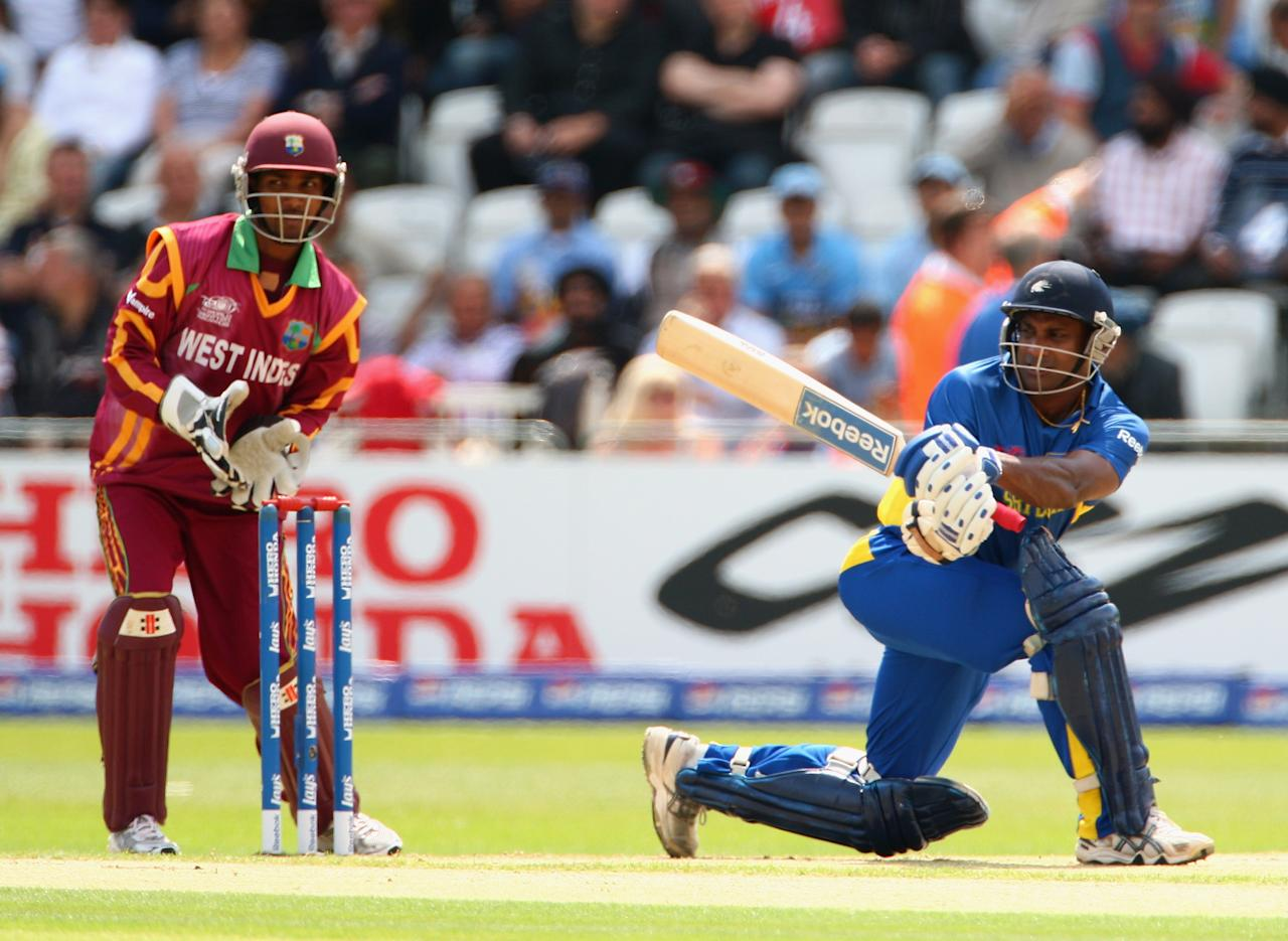 NOTTINGHAM, ENGLAND - JUNE 10:  Sanath Jayasuriya of Sri Lanka hits out during the ICC World Twenty20 match between West Indies and Sri Lanka at Trent Bridge on June 10, 2009 in Nottingham, England.  (Photo by Clive Mason/Getty Images)