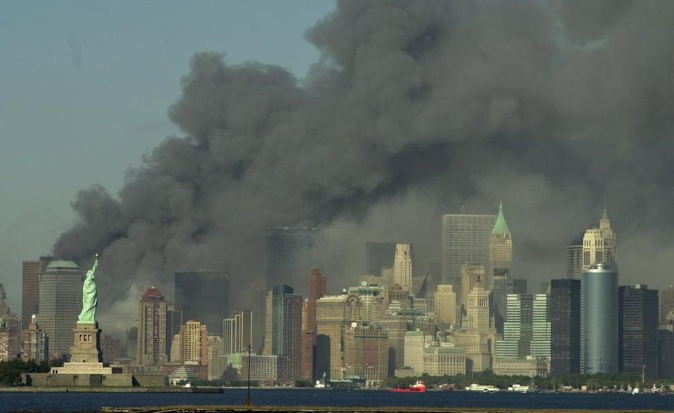 Thick smoke billows into the sky from the area behind the Statue of Liberty (AP)