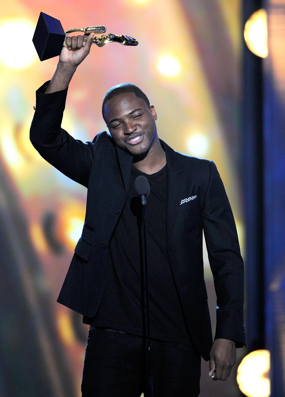 Taio Cruz accepts the Hot 100 Song of the Year award onstage during the 2011 Billboard Music Awards at the MGM Grand Garden Arena May 22, 2011 in Las Vegas, Nevada.  (Photo by Ethan Miller/Getty Images for ABC)
