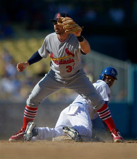 Los Angeles Dodgers' Dee Gordon, bottom, looks back after being tagged out by St. Louis Cardinals second baseman Daniel Descalso while trying to steal second during the seventh inning of their baseball game on Sunday, Sept. 16, 2012, in Los Angeles. (AP Photo/Mark J. Terrill)