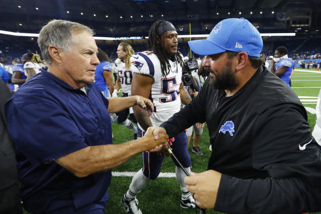 Matt Patricia shares a word with his former boss Bill Belichick on Thursday after a preseason game where the Patriots cruised to a 31-3 victory. (Getty Images)