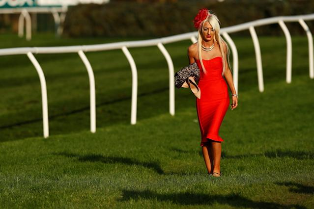 Horse Racing - Grand National Festival - Aintree Racecourse, Liverpool, Britain - April 14, 2018 A racegoer walks by the course Action Images via Reuters/Jason Cairnduff