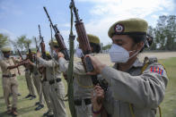 Special police officer recruits who completed nearly three months training demonstrate their weapon skills at Kathua in Indian-controlled Kashmir, Saturday, June 5, 2021. Special police officers are lower-ranked police officials who are mainly recruited for intelligence gathering and counterinsurgency operations. In recent years, the force has assisted in border areas as well because of local recruits' familiarity with the topography and ability to assist police and border guards during emergencies. (AP Photo/Channi Anand)