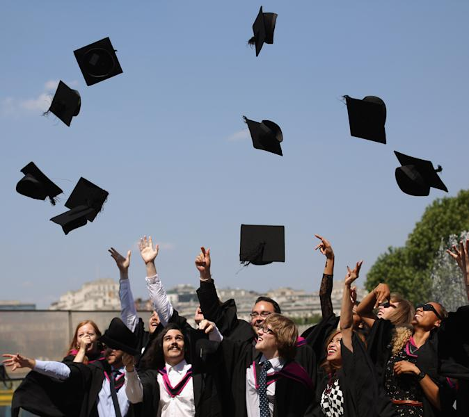 LONDON, UNITED KINGDOM - JULY 18: Graduates celebrate after leaving their graduation ceremony at the Royal Festival Hall on the Southbank in high temperatures on July 18, 2013 in London, England. The United Kingdom is experiencing a second week of heatwave conditions. (Photo by Oli Scarff/Getty Images)