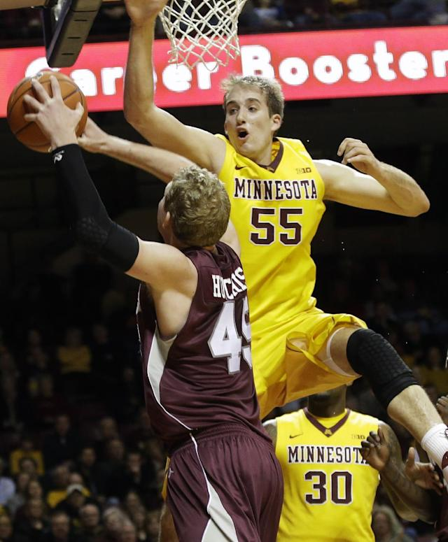 Montana's Eric Hutchison attempts a shot as Minnesota's Elliott Eliason defends in the first half of an NCAA college basketball game, Tuesday, Nov. 12, 2013, in Minneapolis. (AP Photo/Jim Mone)