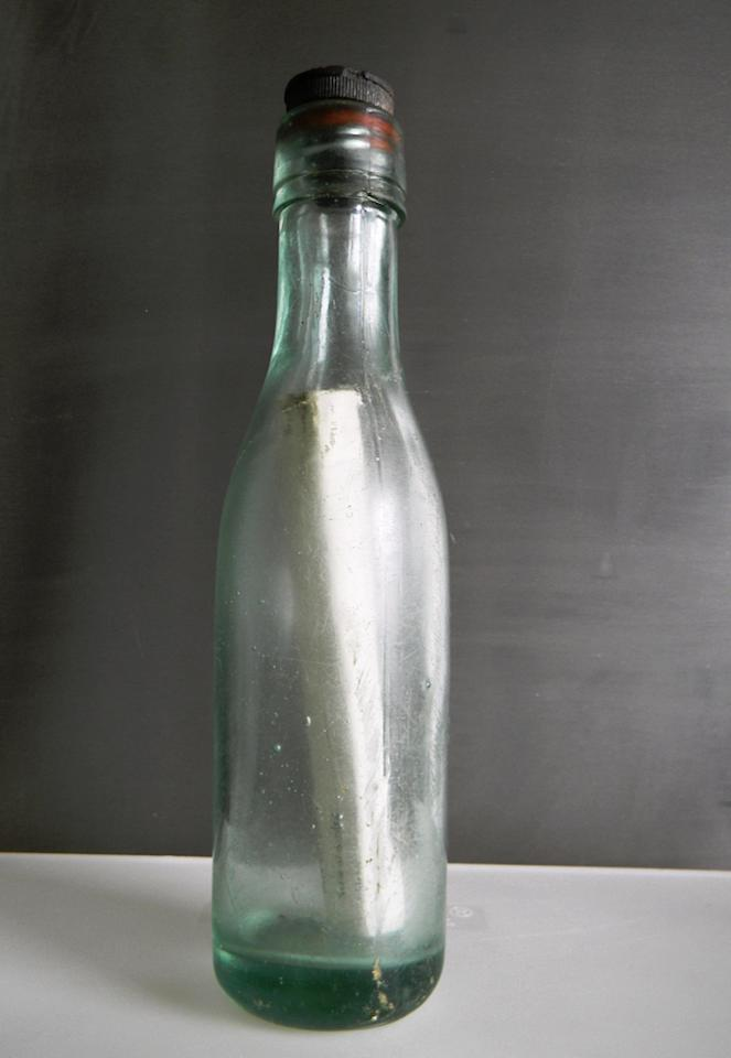 This undated photo made available Thursday Aug. 30, 2012, by the Scottish Government,  showing a message in a bottle discovered by fisherman Andrew Leaper, which set a new world record for the length of time spent at sea, beating the previous record by more than five years.  The bottle was cast into the sea in 1914 as part of a government experiment to map the undercurrents of the seas around Scotland,  and it has turned up nearly 98-years later in a net during a fishing mission east of the Shetland Islands.  The message in this bottle took nearly 98-years to be fished out of the sea near an island off Scotland's northern coast. (AP Photo/Scottish Government, HO)