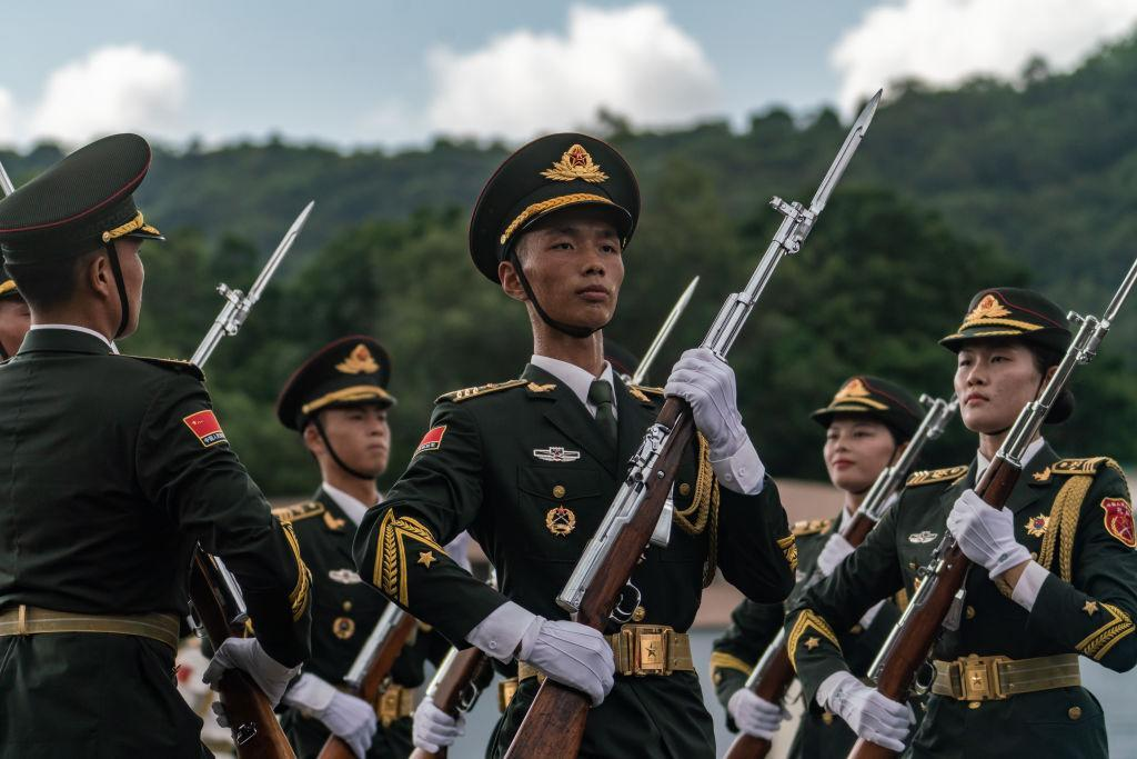 China is developing a laser-powered rifle that can set people on fire from  half a mile away
