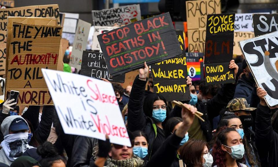 Demonstrators demand an end to frequent Aboriginal deaths in custody in Australia at a protest in Melbourne.
