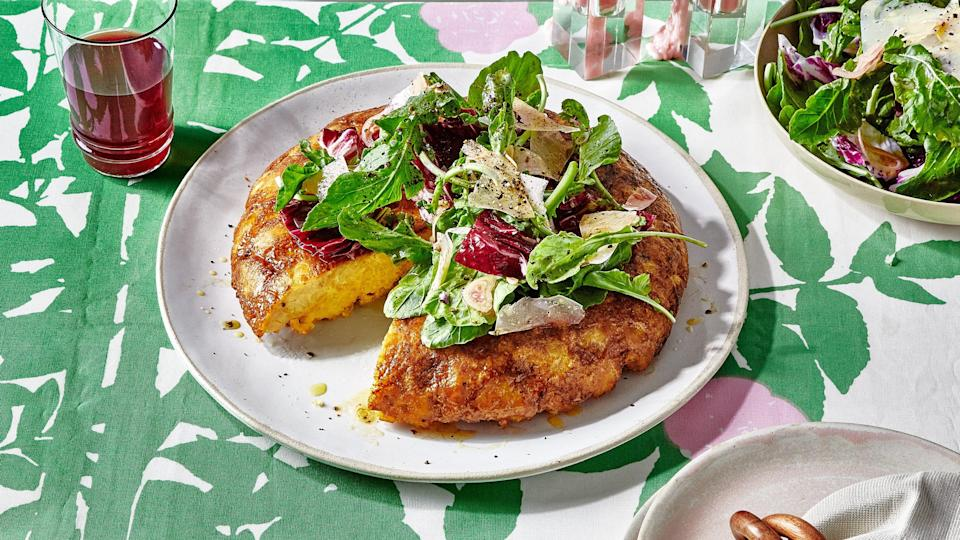 """<a href=""""https://www.bonappetit.com/recipe/tater-tot-egg-bake-with-bitter-greens-salad?mbid=synd_yahoo_rss"""" rel=""""nofollow noopener"""" target=""""_blank"""" data-ylk=""""slk:See recipe."""" class=""""link rapid-noclick-resp"""">See recipe.</a>"""