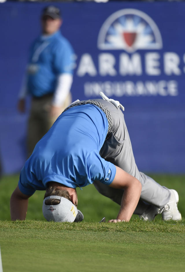 Sebastian Cappelen of Denmark reacts after missing chip shot on the 15th hole of the South Course at Torrey Pines Golf Course during the third round of the Farmers Insurance golf tournament Saturday Jan. 25, 2020, in San Diego. (AP Photo/Denis Poroy)