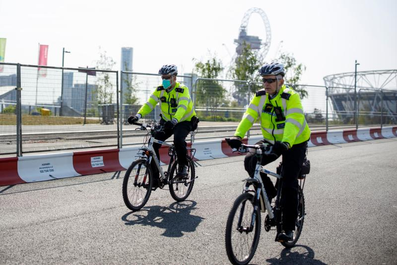 Police officers patrol in Queen Elizabeth Olympic Park in east London on April 24, 2020 during the national lockdown due to the novel coronavirus COVID-19 pandemic. (Photo by Tolga AKMEN / AFP) (Photo by TOLGA AKMEN/AFP via Getty Images)