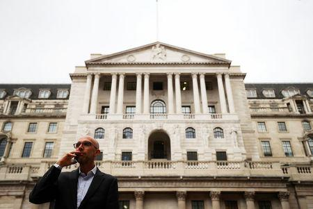 A man speaks on his mobile phone outside the Bank of England in London