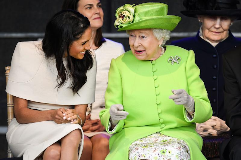 The Duchess of Sussex wore a cream-hued Givenchy dress for her debut engagement with the Queen - who chose a zesty lime ensemble by Stewart Palvin. [Photo: Getty]