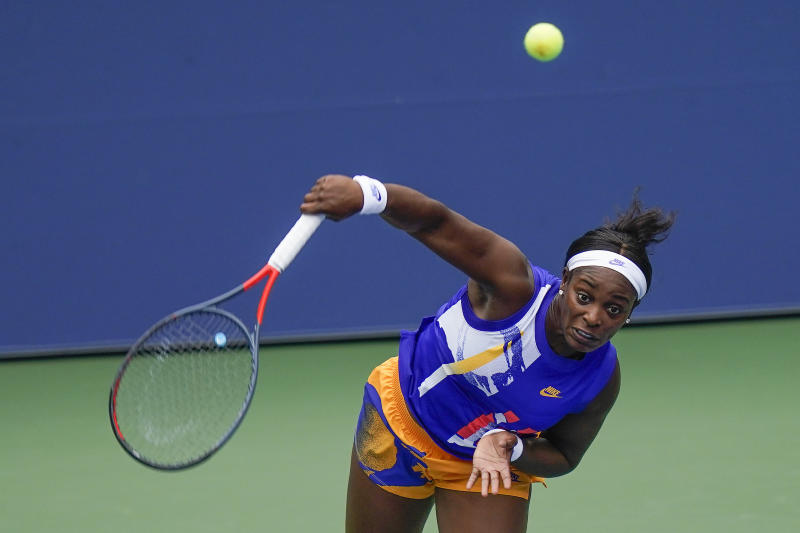 Sloane Stephens, of the United States, serves to Olga Govortsova, of Belarus, during the second round of the US Open tennis championships, Thursday, Sept. 3, 2020, in New York. (AP Photo/Seth Wenig)