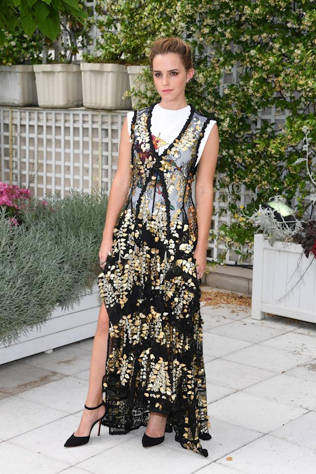 <p>For her second look of the day, Emma wore an embellished sheer dress paired with Santoni black heels. <br /><em>[Photo: Getty] </em> </p>