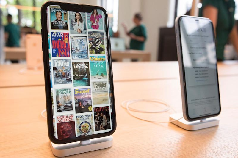 iPhones are on display as Apple opens their new store, Apple Carnegie Library, in Washington, Saturday, May 11, 2019. (AP Photo/Cliff Owen)