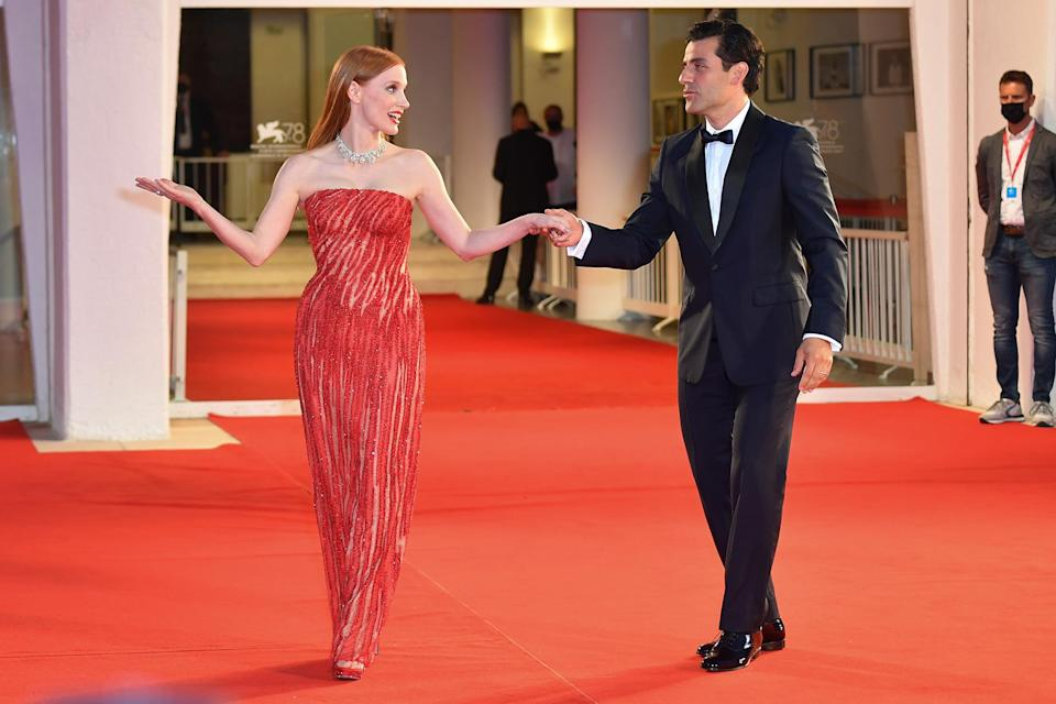 """<p>Chastain playfully responded to the buzz around their viral red carpet moment by <a href=""""https://twitter.com/jes_chastain/status/1434797225742372864"""" rel=""""nofollow noopener"""" target=""""_blank"""" data-ylk=""""slk:tweeting a black-and-white still of Morticia and Gomez Addams of The Addams Family"""" class=""""link rapid-noclick-resp"""">tweeting a black-and-white still of Morticia and Gomez Addams of <em>The Addams Family</em></a> posed in a similar way. The actress accompanied the post with the simple caption including the show's premiere date, """"Sept 12th,"""" and a purple devil emoji. </p>"""