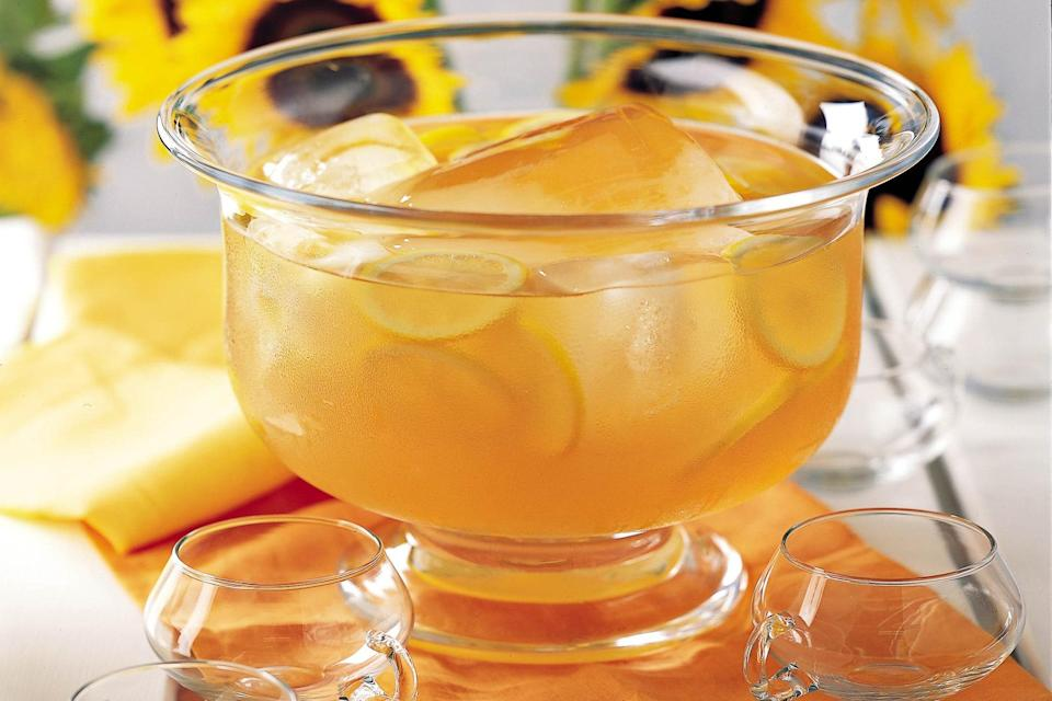 """This potent punch (packed with rum, Cognac, and peach brandy) can be diluted with cold black tea or with seltzer water, for a bit of fizz. <a href=""""https://www.epicurious.com/recipes/food/views/fish-house-punch-230583?mbid=synd_yahoo_rss"""" rel=""""nofollow noopener"""" target=""""_blank"""" data-ylk=""""slk:See recipe."""" class=""""link rapid-noclick-resp"""">See recipe.</a>"""