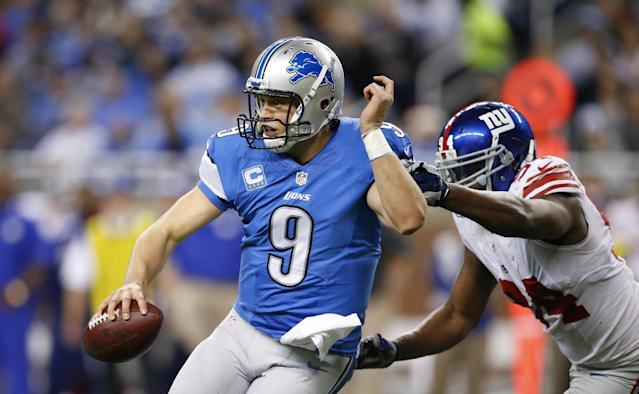 Detroit Lions quarterback Matthew Stafford (9) is chased by New York Giants defensive end Mathias Kiwanuka (94) during the second quarter of an NFL football game, Sunday, Dec. 22, 2013, in Detroit. (AP Photo/Rick Osentoski)