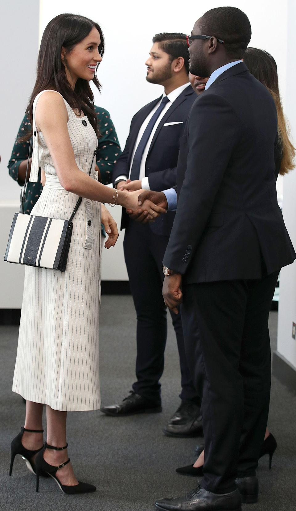 <p>Meghan Markle broke tradition by removing her jacket inside the event. </p>