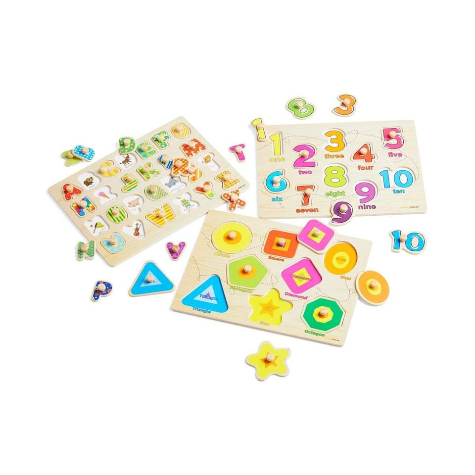 """<p>This set of three colorful <a href=""""https://www.popsugar.com/buy/Orange-Pieces-Wooden-Peg-Puzzles-557156?p_name=Orange%20Pieces%20Wooden%20Peg%20Puzzles&retailer=amazon.com&pid=557156&price=20&evar1=moms%3Aus&evar9=47312779&evar98=https%3A%2F%2Fwww.popsugar.com%2Ffamily%2Fphoto-gallery%2F47312779%2Fimage%2F47312782%2FOrange-Pieces-Wooden-Peg-Puzzles&list1=amazon%2Cindoor%20activities%2Cpuzzles%2Ckid%20activities&prop13=api&pdata=1"""" rel=""""nofollow"""" data-shoppable-link=""""1"""" target=""""_blank"""" class=""""ga-track"""" data-ga-category=""""Related"""" data-ga-label=""""https://www.amazon.com/Wooden-Peg-Puzzle-toddlers-Alphabet/dp/B06Y16Z5PC/"""" data-ga-action=""""In-Line Links"""">Orange Pieces Wooden Peg Puzzles</a> ($20) teach kids shapes, numbers, and letters.</p>"""