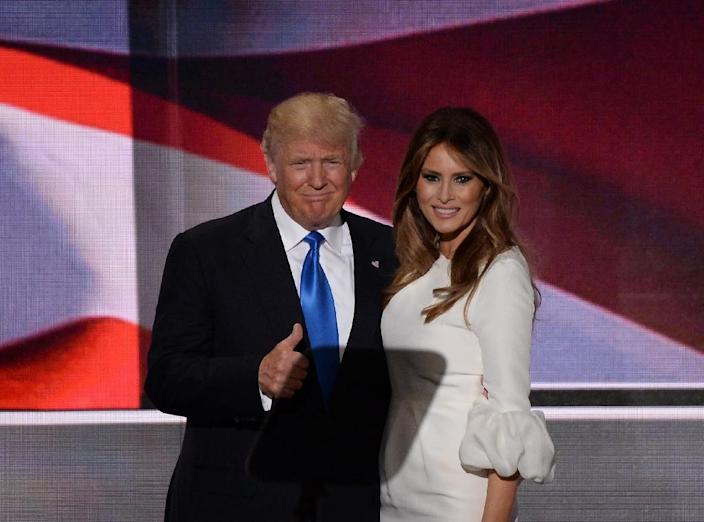 Republican presidential candidate Donald Trump stands on stage with his wife Melania Trump following her address to delegates at the Republican National Convention in Cleveland, Ohio, on July 18, 2016 (AFP Photo/Robyn Beck)