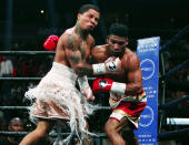 CORRECTS DATE - Gervonta Davis, left, lands a punch on Yuriorkis Gamboa during round six for the WBA lightweight boxing bout Sunday, Dec. 29, 2019, in Atlanta. Davis won the title by a 12th round TKO. (AP Photo/Tami Chappell)