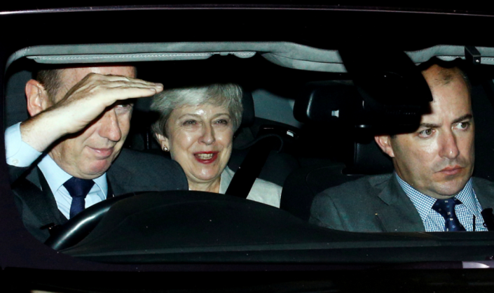 Theresa May left Parliament with a smile on her face following Boris Johnson's defeat (Reuters)