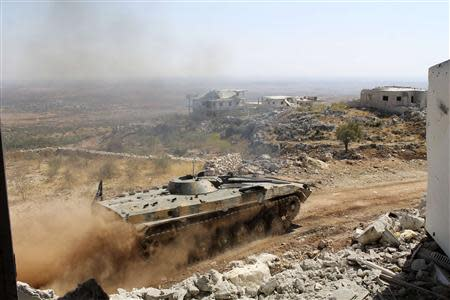 A Free Syrian Army tank drives on al-Arbaeen mountain in the Idlib countryside September 20, 2013. Picture taken September 20, 2013. REUTERS/Houssam Abo Dabak