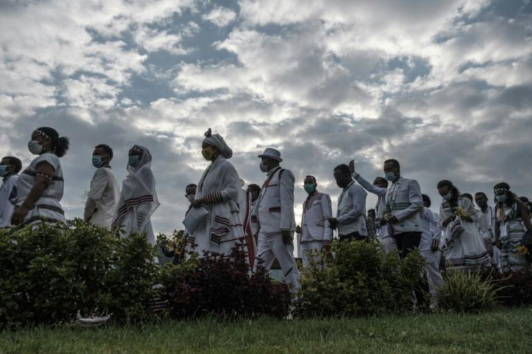 People in traditional clothing march during the celebration of the Oromo people's annual thanksgiving holiday, in Addis Ababa, Ethiopia.