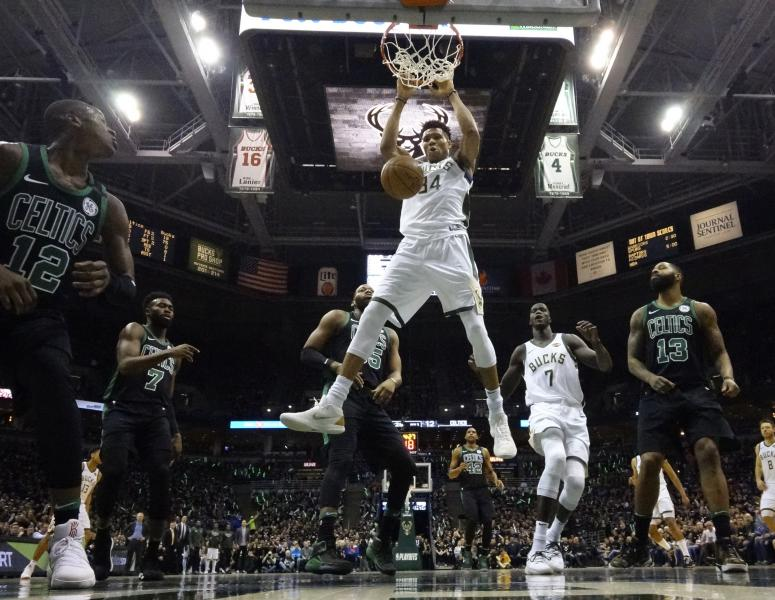 Milwaukee Bucks' Giannis Antetokounmpo dunks during the first half of Game 4 of an NBA basketball first-round playoff series against the Boston Celtics Sunday, April 22, 2018, in Milwaukee. (AP Photo/Morry Gash)