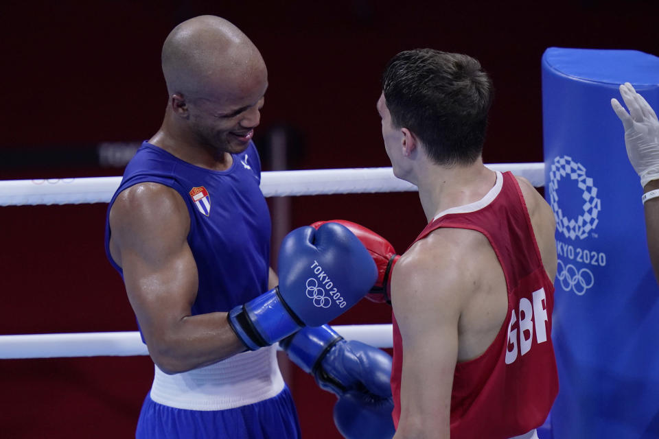 Britain's Pat McCormack right and Cuba's Roniel Iglesias after their men's welterweight 69-kg boxing match at the 2020 Summer Olympics, Tuesday, Aug. 3, 2021, in Tokyo, Japan. (AP Photo/Frank Franklin II)