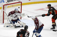 Colorado Avalanche goalie Philipp Grubauer (31) stops a shot by Anaheim Ducks forward Ryan Getzlaf (15) during the second period of an NHL hockey game in Anaheim, Calif., Friday, Jan. 22, 2021. (AP Photo/Ringo H.W. Chiu)