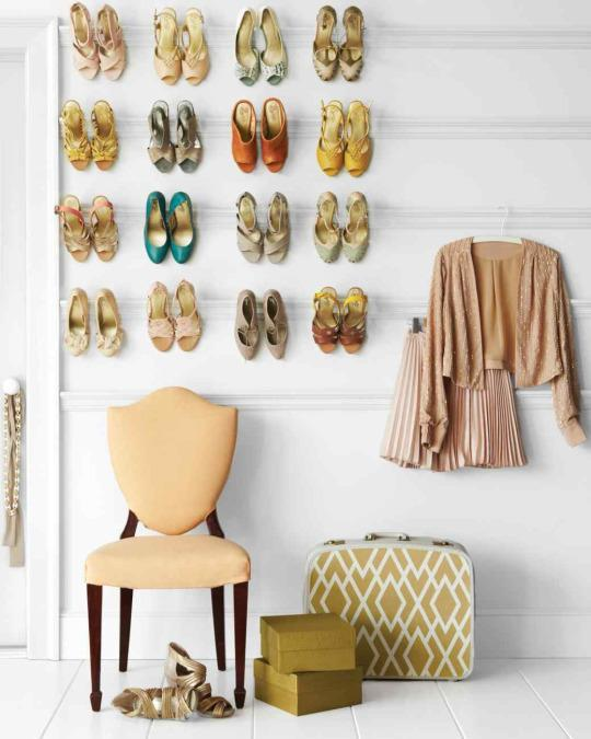 <p>Keep your shoes from piling on the ground with an in-closet shoe organizer or a wall-mounted display like this one. This way, you can easily see all of the pairs you have, and keep matches together.</p>