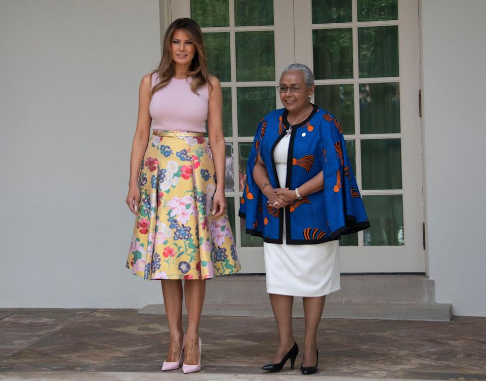 Melania Trump stood next to the wife of President Uhuru Kenyatta of the Republic of Kenya, Mrs. Margaret Kenyatta, as the FLOTUS welcomed the leaders to the White House with her husband. For the occassion, she wore a £3,100 Valentino skirt and four-inch Louboutin heels. This outfit choice was amusing to some, especially as part of the days activities included a spot of gardening on the White House lawn. [Photo: Rex]