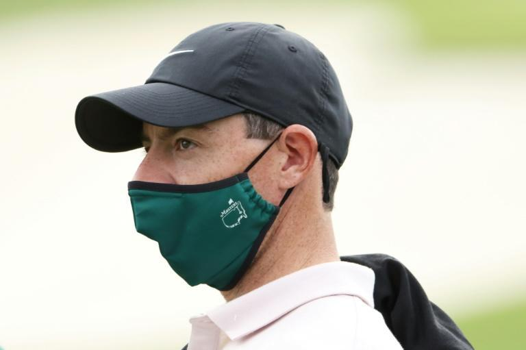 Four-time major winner Rory McIlroy wears a Masters facemask while practicing ahead of Thursday's start of the 84th Masters